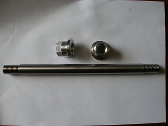 Triumph titanium rear wheel spindle and 7075 alloy nuts