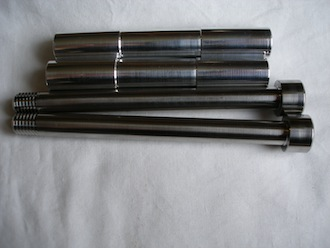 Buell 7075 alloy fottrest sleeves and titanium retaining bolts