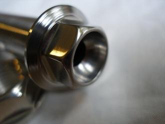 Montessa titanium swinging arm axle head