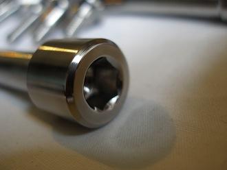 Montessa titanium top shock bolt head