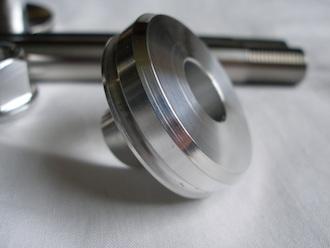 Triumph triple 7075 alloy swinging arm bearing holder