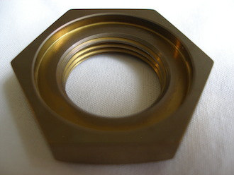 R1 gold anodised titanium gearbox sprocket nut counterbore