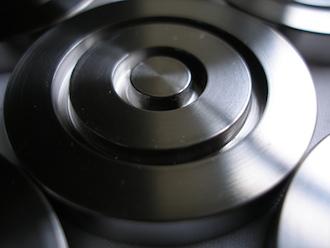 Titanium acoustic puck, frequency breaker