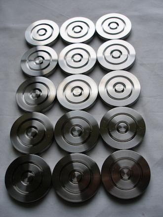 Titanium acoustic pucks
