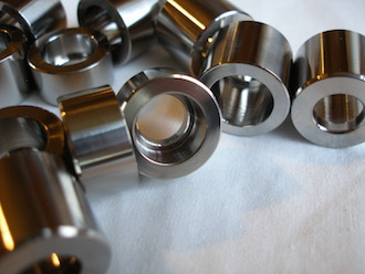 Titanium bucket spacers