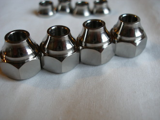 Titanium profiled sleeve nuts