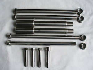Montessa titanium wheel spindles and suspension bolts