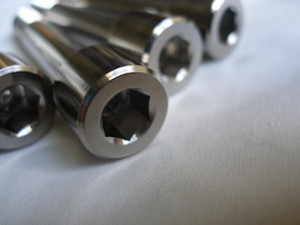 Montessa titanium suspension mounting bolt heads