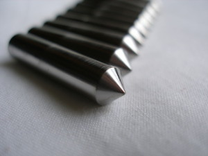 Titanium acoustic isolation spikes, spikey end