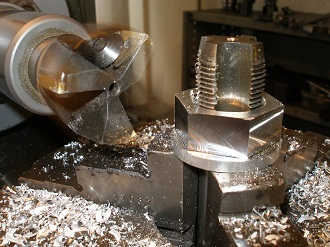 7075 alloy R6 rear axle nut, machining the flats