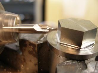 titanium magnetic sump plugs, having the lockwire holes drilled
