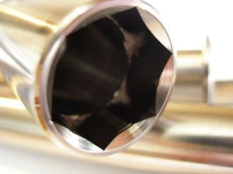 Montessa titanium front wheel spindle head