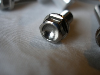 Titanium M6 bolt head, scooped out for extra lightness!