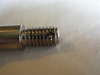 Titanium brake anchor bolt, split pin hole