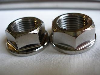 Titanium Montessa wheel spindle nuts