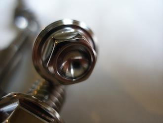 Montessa titanium pin bolt head