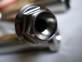 Titanium Montessa swinging arm spindle head