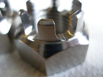 M16 titanium castle nut castellations
