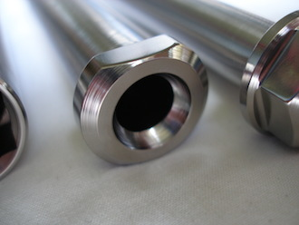 Montessa titanium rear wheel spindle head