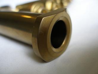 R1 gold anodised titanium rear axle head
