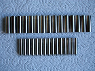 Titanium acoustic shafts and spikes