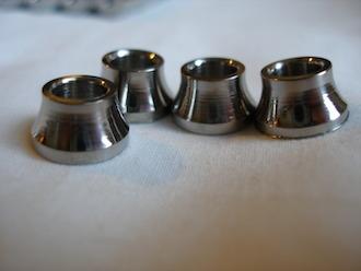 Titanium profiled spacers