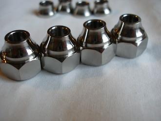 Titanium profiled sleeve nuts