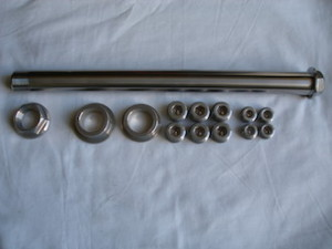 Kawasaki ZXR titanium swinging arm axle with 7075 alloy spacers and grub screws