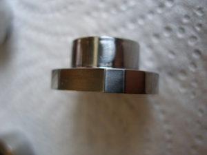 KTM BST titanium sprocket nut, like a thrupenny bit!