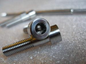 Titanium Aprilia subframe bolt, M5 tapping